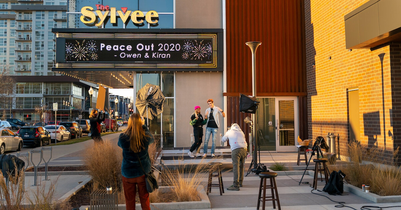 Chris Lotten photographs Kiren Sanders and Owen Christen in front of the The Sylvee marquee on Dec. 4. (Photo © Andy Manis)