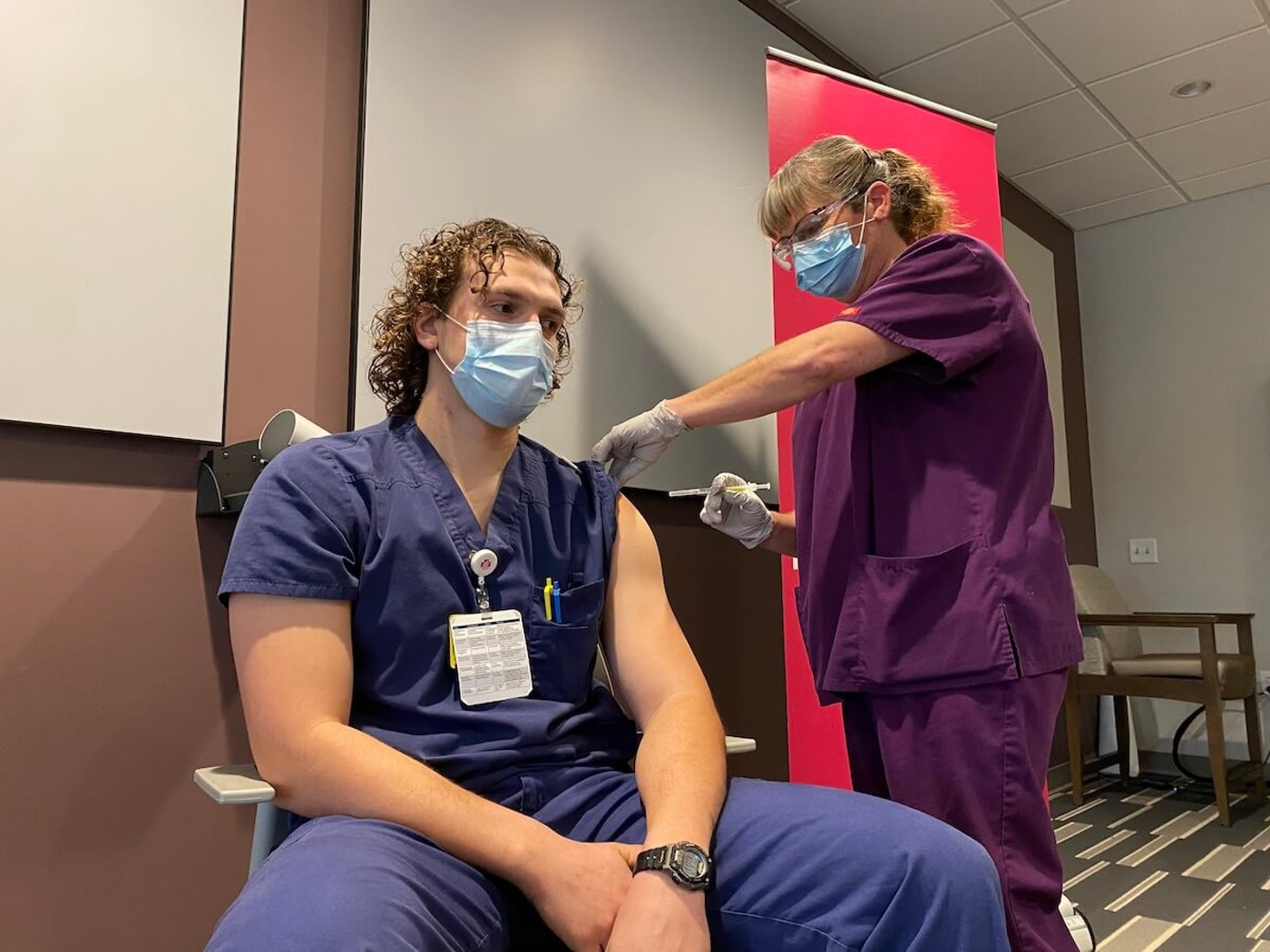 Jacob Luttropp, a registered nurse at Marshfield Medical Center-Eau Claire who works directly with COVID-19 patients, became the first healthcare worker there to receive a vaccine to protect against the virus on Dec. 18. (Julian Emerson photo).