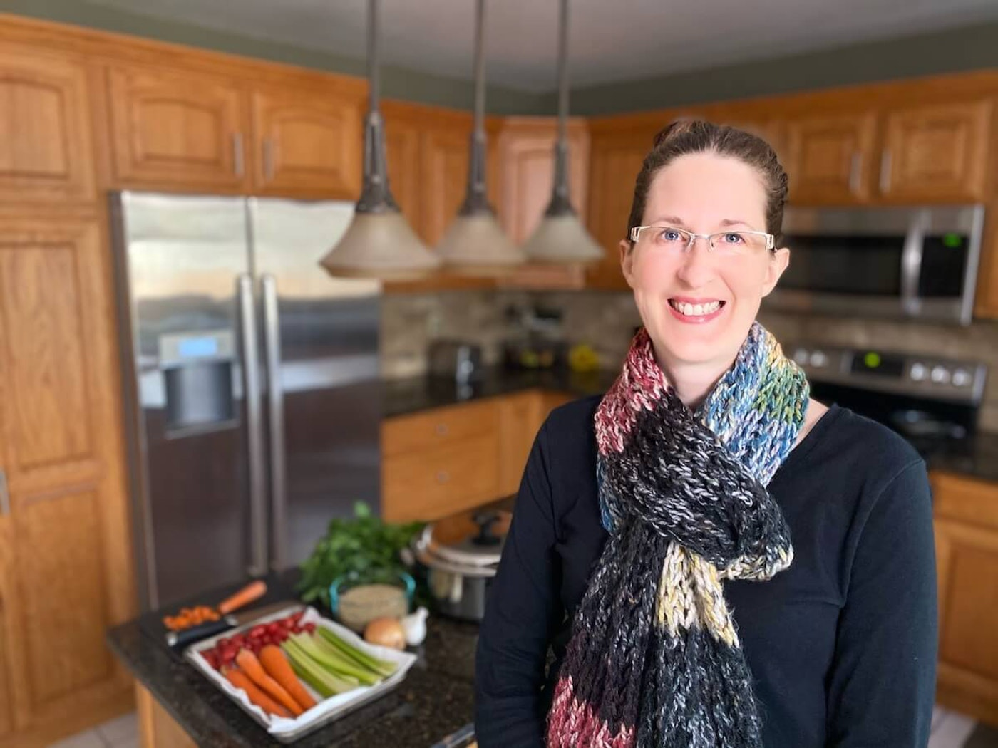 """Jennifer Hafele prepares a meal Wednesday afternoon for an Eau Claire healthcare worker and their family as part of the """"Lessening the Load"""" effort to assist those employees as they deal with the coronavirus pandemic. (Photo courtesy of Jennifer Hafele)"""