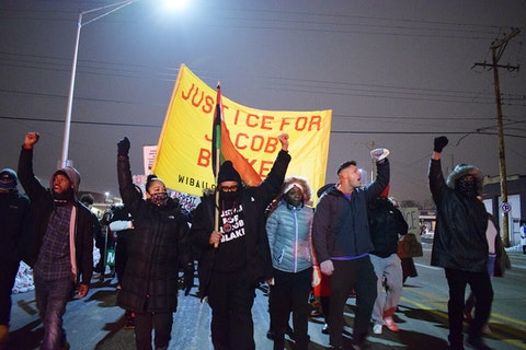 Justin Blake and activists march Monday evening for Jacob Blake