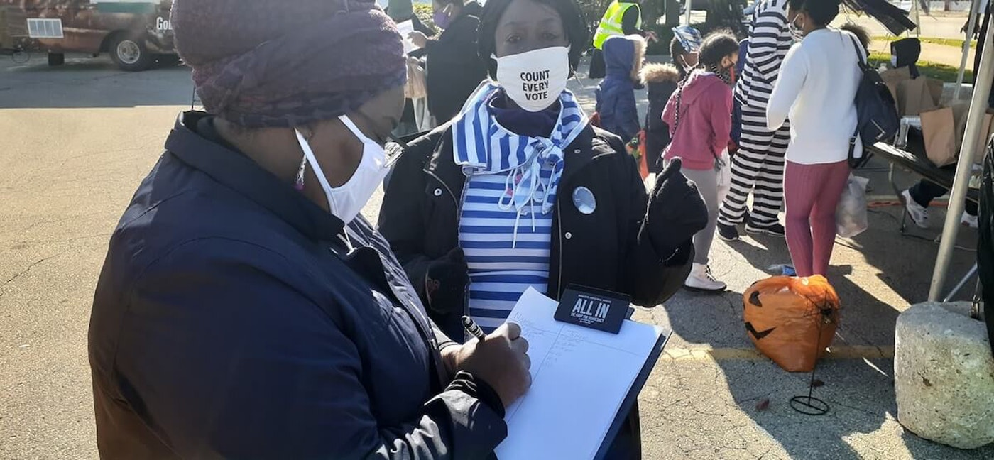 Maletha Jones (holding clipboard), Field Operations Manager for Black Leaders Organizing Communities (BLOC) takes part in an event the week before the Nov. 3, 2020 election.