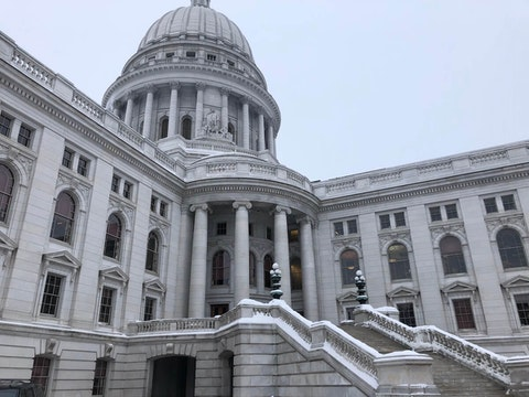 A light dusting of snow is seen on and around the state Capitol in Madison as the Wisconsin Legislature begins its new session on Jan. 4, 2021. (Photo by Jessica VanEgeren)