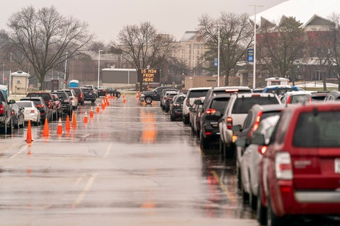 People wait in their cars for a COVID-19 test at the Alliant Energy Center in Madison on November 24, 2020.