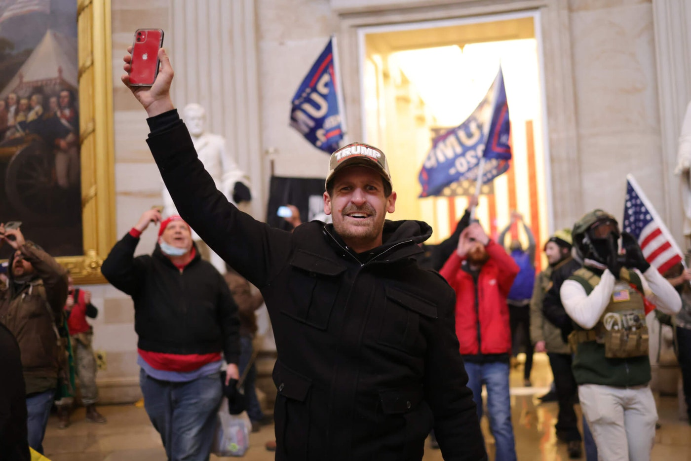 Rioters enter the U.S. Capitol Building on Jan. 6 in Washington, DC. Congress held a joint session to ratify President-elect Joe Biden's 306-232 Electoral College win over President Donald Trump. A group of Republican senators said they would reject the Electoral College votes of several states unless Congress appointed a commission to audit the election results. (Photo by Win McNamee/Getty Images)