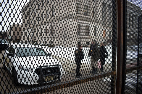 Sheriff's deputies stand outside the fenced-off Kenosha County Courthouse Monday afternoon.