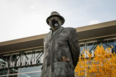 In a sign of the times, the statue of legendary Green Bay Packers coach Vince Lombardi has been masked up since early in the coronavirus pandemic.