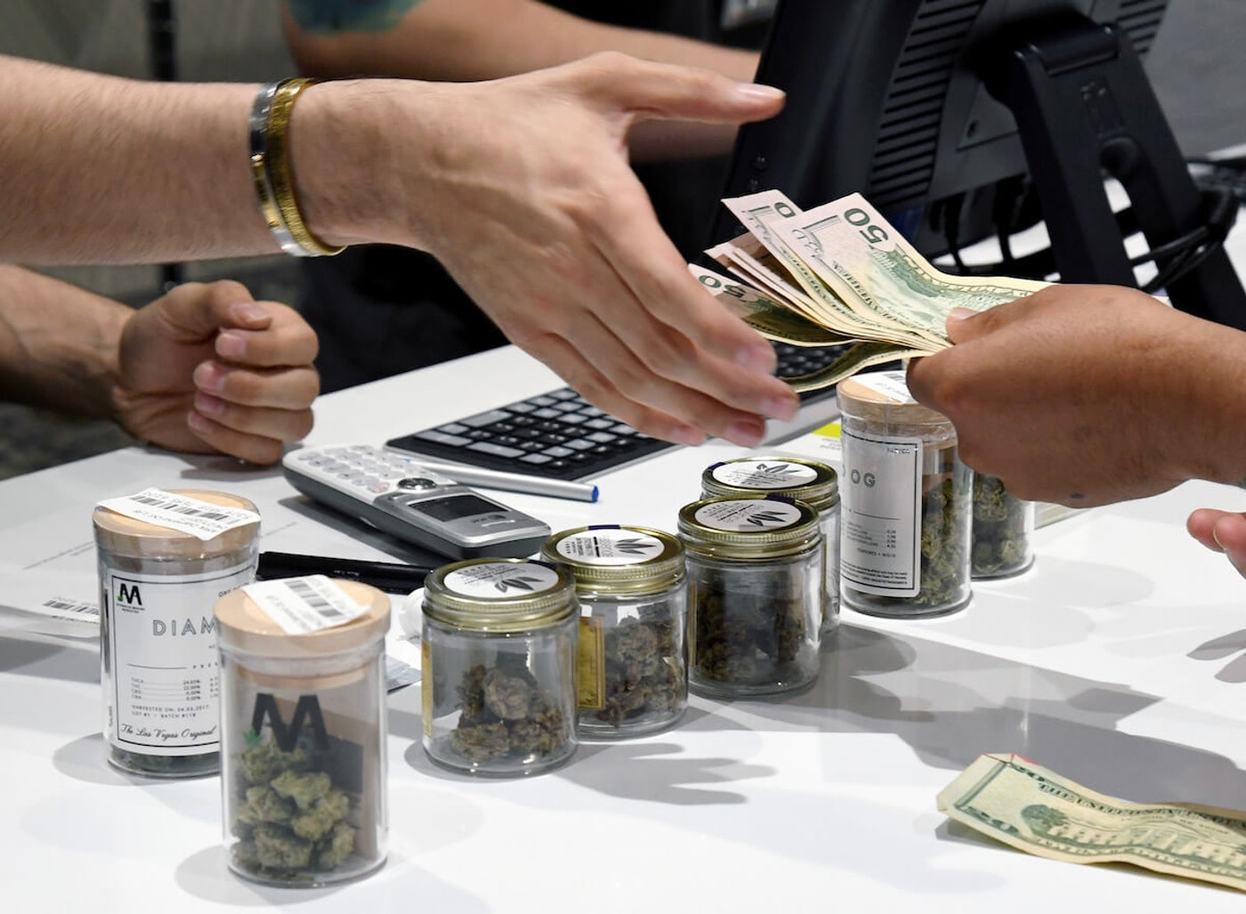 FILE - In this 2017 photo, a customer pays for cannabis products at Las Vegas dispensary. (Photo by Ethan Miller/Getty Images)