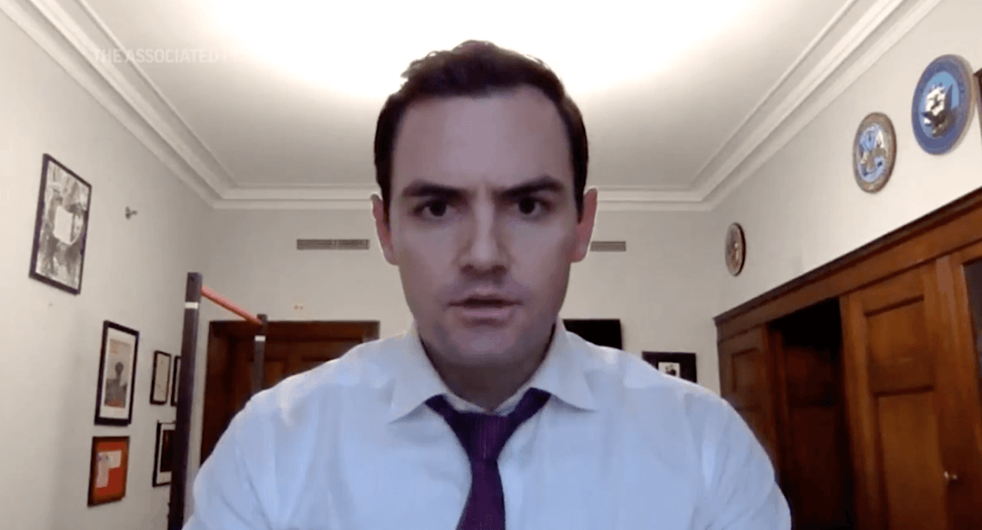 """US Rep. Mike Gallagher (R-Green Bay), locked down in his Washington, DC office during the insurrection of Jan. 6, 2021, tells former President Trump that he directly needs to """"call off"""" the violent protesters. (Image via the Associated Press)"""