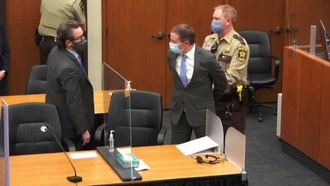 Former Minneapolis police Officer Derek Chauvin, center, is taken into custody as his attorney, Eric Nelson, left, looks on, after the verdicts were read at Chauvin's trial for the 2020 death of George Floyd.