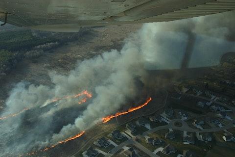 fire by homes in menomonee falls
