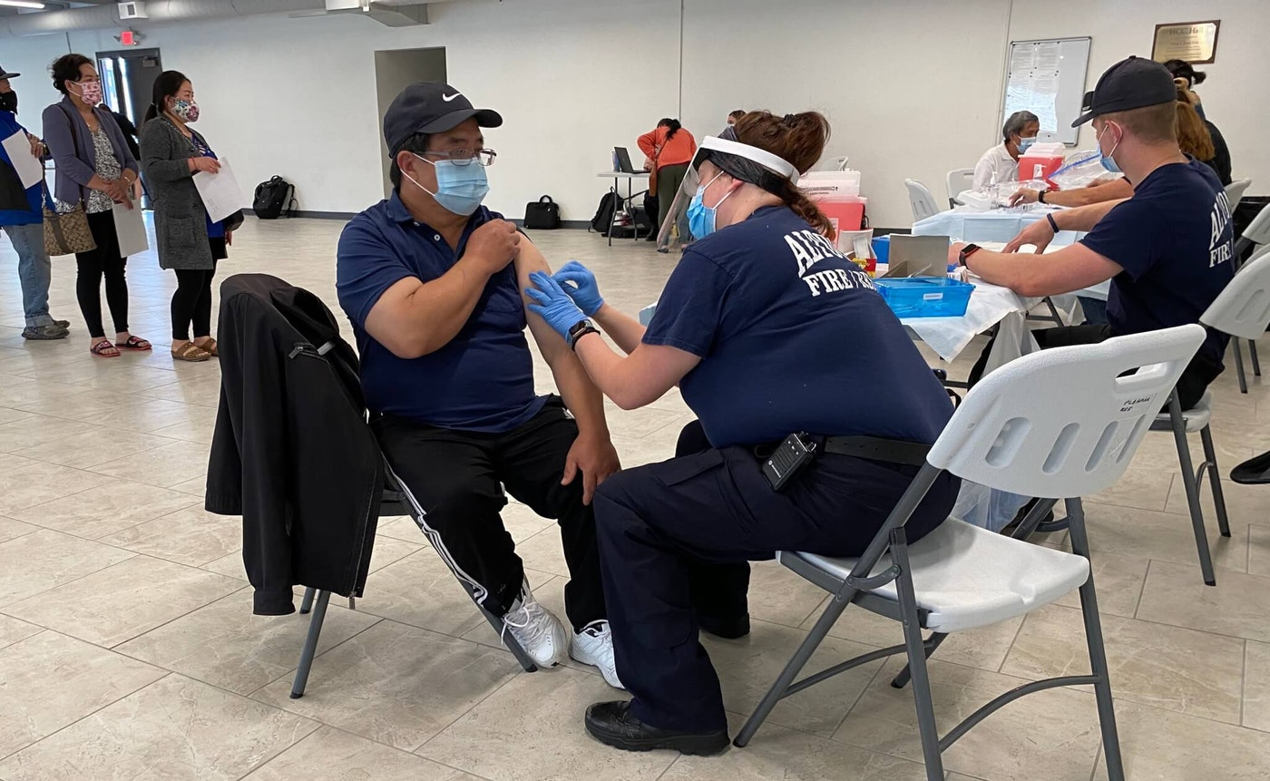 A Hmong man receives a COVID-19 vaccination May 10 in Eau Claire during a vaccine clinic put on by the Eau Claire City-County Health Department and the city's Hmong Mutual Assistance Association. Such clinics are an effort to increase the lagging vaccination rate in Wisconsin. (Photo by Julian Emerson)