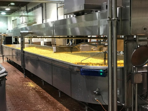 Cheese curds being made at the Wisconsin Dairy State Cheese Company in Rudolph. (Image via Shutterstock)