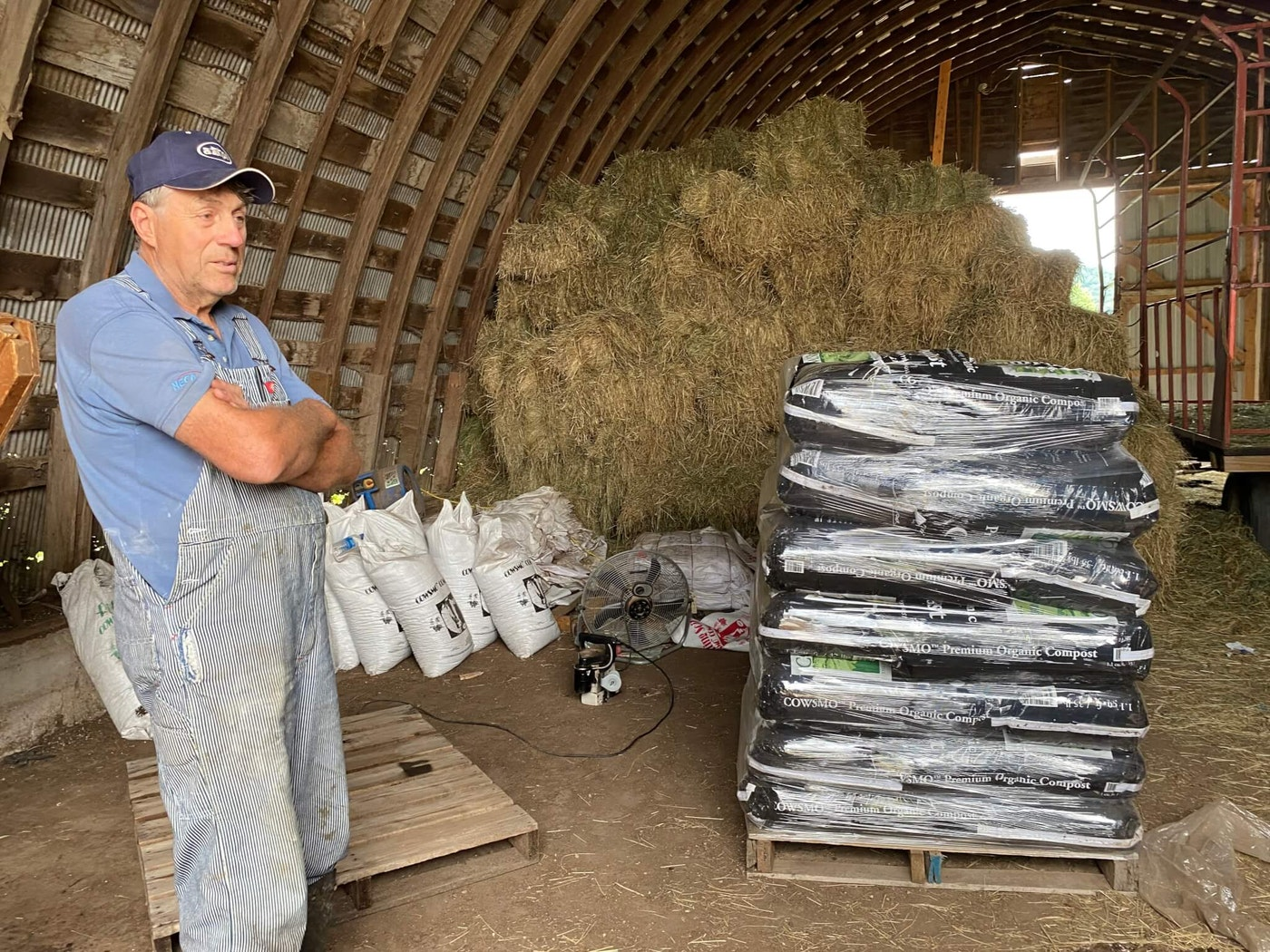 John Rosenow discusses the Cowsmo Compost business he operates and said doing that plus trying to operate his 800-acre dairy farm wouldn't be possible without the help of the 20 employees who work for him. (Photo by Julian Emerson)