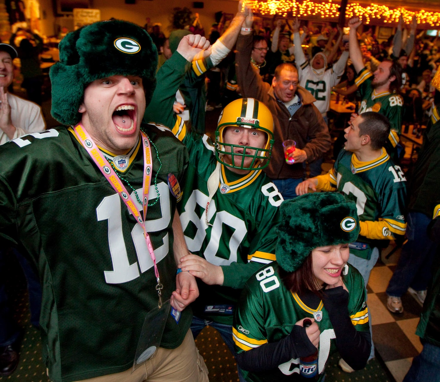 Green Bay Packers fans celebrate Sunday, Feb. 6, 2011, at the Stadium View Bar near Lambeau Field in Green Bay, Wis. after the Packers won Super Bowl XLV. (AP Photo/Mike Roemer)