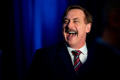 """My Pillow CEO Michael Lindell laughs during a """"Keep Iowa Great"""" press conference in Des Moines, IA, on February 3, 2020. (Photo by JIM WATSON/AFP via Getty Images)"""