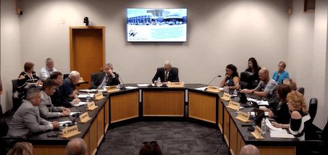 The Waukesha Board of Education meets to vote on opting back into a federal free meals program. (Screenshot via Waukesha School District TV/YouTube)