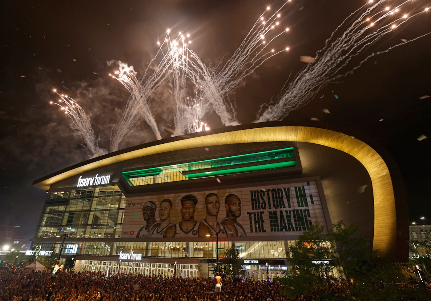 Fireworks explode over Fiserv Forum after the Milwaukee Bucks defeated the Phoenix Suns in Game 6 of the NBA Finals to win the NBA Championship early Tuesday, July 20, 2021, in Milwaukee. (AP Photo/Jeffrey Phelps)