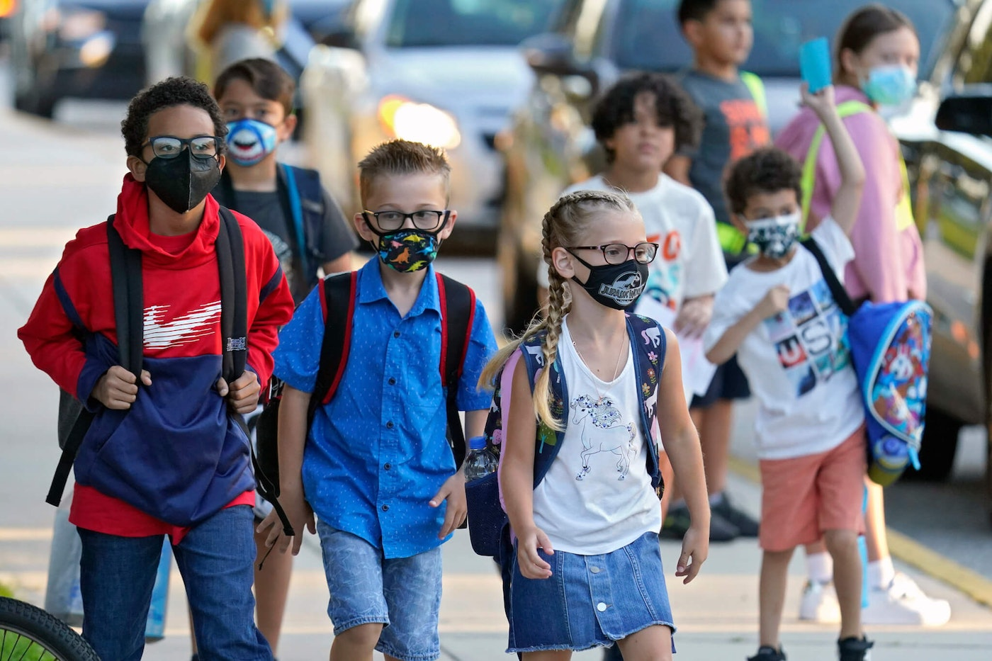 Students, some wearing protective masks, arrive for the first day of school at a Florida elementary school. (AP Photo/Chris O'Meara, File)