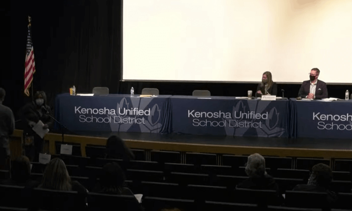 Residents of the Kenosha Unified School District, led by a local chapter of a right-wing activist group, recently voted to slash pay for school board members and require them to attend meetings in person to get paid. It is just one example of a district where school board members are being punished, threatened, or even recalled for enacting COVID-19 safeguards. (Screenshot via Kenosha Unified School District/Youtube)