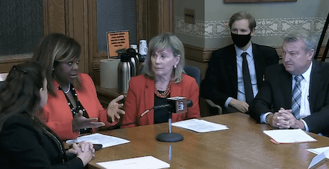 From left: Rep. Jill Billings (D-La Crosse), Sen. LaTonya Johnson (D-Milwaukee), Sen. Alberta Darling (R-River Hills), and Rep. Joel Kitchens (R-Sturgeon Bay) testify before the Senate Judiciary and Public Safety Committee on Thursday in support of a bill that bars charging minors with prostitution and instead provides resources to them as sex trafficking survivors. (Screenshot via WisconsinEye)
