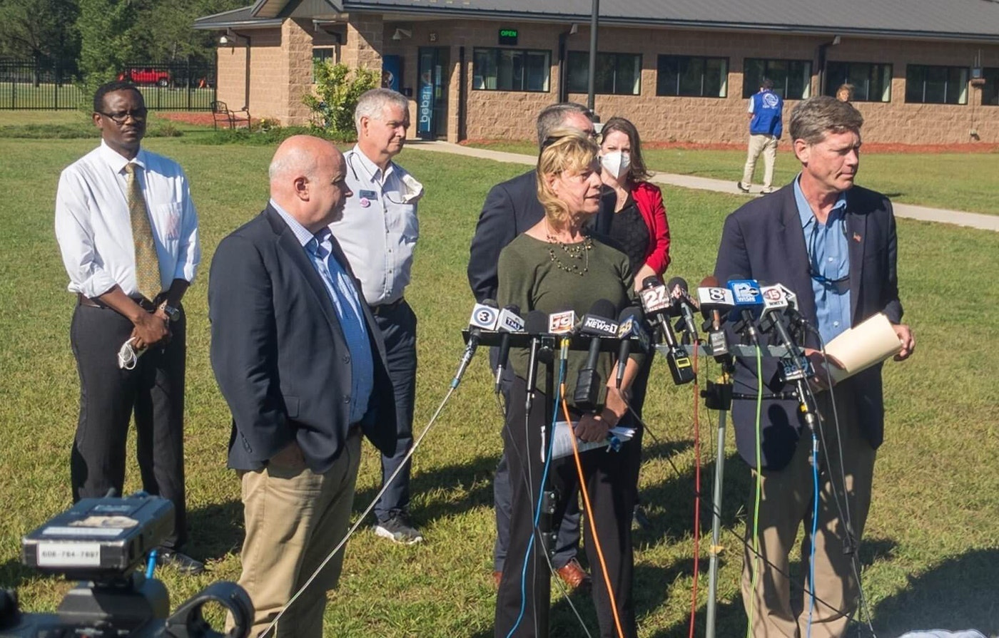 Democratic state and federal lawmakers speak to reporters Tuesday after visiting Afghan refugees at Fort McCoy.