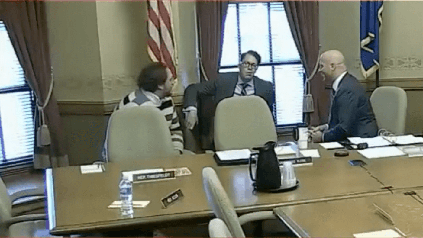In this screen grab of video from WisconsinEye, Cameron Sholty (center) from the Heartland Institute and a former Capitol staffer and Bill Neville (right) from Rep. Chuck Wichgers' (R-Muskego) office hold a conversation about two Democratic women during a break in a committee hearing.
