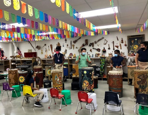 La Casa de Esperanza Charter School Teacher Jesus Avila leads his class in a traditional Aztec drumming performance. The charter school is just one of the many educational missions of La Casa de Esperanza, a nonprofit that has served the Waukesha community for more than 50 years. (Photo by Cara Spoto)