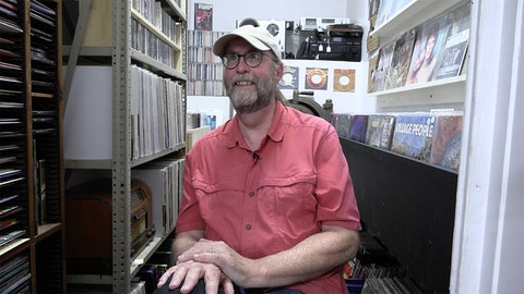 Steve Cotherman is the manager of the Washburn Cultural Center and proud curator of the Vinyl Vault. He is happy to send anyone home with a stack of classics. (Photo by JT Cestkowski)