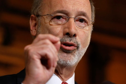 FILE - In this Dec. 29, 2015 file photo, Pennsylvania Gov. Tom Wolf speaks with members of the media at the state Capitol in Harrisburg, Pa. Wolf is attacking local elected officials making plans to reopen in defiance of his shutdown orders as cowards deserting the pandemic battlefield. Wolf threatened Monday, May 11, 2020 to block aid to rebellious counties in an escalating political fight over his administration's handling of the coronavirus. (AP Photo/Matt Rourke, File)
