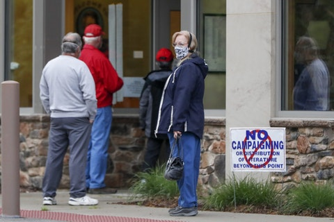 People wait outside their voting place before the polls open for the Pennsylvania Primary election, Tuesday, June 2, 2020, in Zelienople, Pa. (AP Photo/Keith Srakocic)