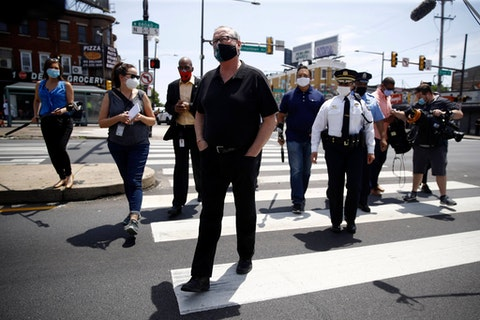 Philadelphia Mayor Jim Kenney walks across Broad Street to meet with people Thursday, June 4, 2020, in Philadelphia, after days of protest over the May 25 death of George Floyd, who died after being restrained by police in Minneapolis. (AP Photo/Matt Rourke)