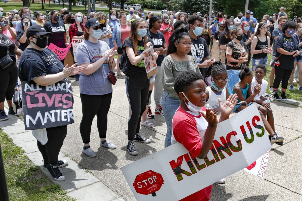 People attending a rally against racism clap and hold signs Saturday, June 13, 2020, in Beaver, Pa. in a protest in the wake of the death of George Floyd who died after being restrained by Minneapolis police officers on May 25. (AP Photo/Keith Srakocic)