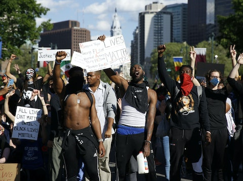 Protesters gather on the Ben Franklin Parkway in Philadelphia, Monday, June 1, 2020 during a march calling for justice over the death of George Floyd, Floyd died after being restrained by Minneapolis police officers on May 25. (AP Photo/Matt Slocum)