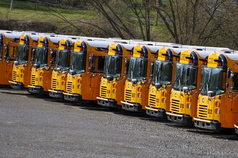 School buses are parked at a depot Thursday, April 9, 2020, in Zelienople, Pa. Pennsylvania Gov. Tom Wolf said Thursday that schools will remain shuttered for the rest of the academic year because of the coronavirus pandemic. (AP Photo/Keith Srakocic)