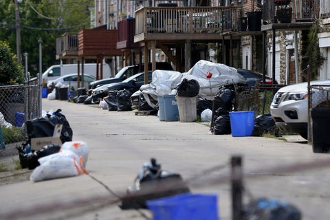 In this photo from May 13, 2020, bags of garbage sit along the street before being picked up in Philadelphia's Ogontz section. Households are generating more trash as people stay home during the coronavirus pandemic. The city's 311 complaint line has received 9,753 calls about trash and recycling as of July 29 compared to 1,873 in February. (Tim Tai/The Philadelphia Inquirer via AP)