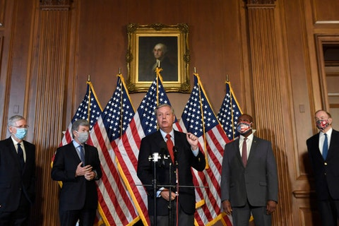Sen. Lindsey Graham, R-S.C., center, speaks during a news conference on on Capitol Hill in Washington, Monday, July 27, 2020, to highlight the Republican proposal for the next coronavirus stimulus bill. Joining Graham, from left, is Senate Majority Leader Mitch McConnell of Ky., Sen. Roy Blunt, R-Mo., Sent. Tim Scott, R-S.C., and Sen. Richard Shelby, R-Ala. (AP Photo/Susan Walsh)