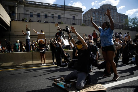 Protesters gather on Interstate 676 in Philadelphia, Monday, June 1, 2020 during a march calling for justice over the death of George Floyd in Philadelphia, Monday, June 1, 2020. Floyd died after being restrained by Minneapolis police officers on May 25. (AP Photo/Matt Rourke)