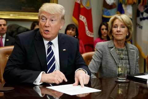 President Donald Trump accompanied by Education Secretary Betsy DeVos. (AP Photo/Evan Vucci)