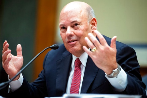 In this Aug. 24, 2020, file photo, Postmaster General Louis DeJoy testifies during a House Oversight and Reform Committee hearing on the Postal Service on Capitol Hill in Washington. President Donald Trump says he's open to an investigation of  DeJoy after some of DeJoy's former employees said they felt pressured to donate to GOP candidates. (Tom Williams/Pool via AP)