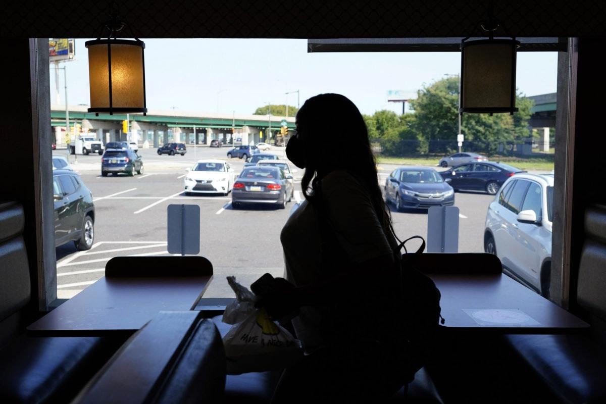 A customer walks through the Penrose Diner after eating indoors during the coronavirus, Tuesday, Sept. 8, 2020, in Philadelphia. (AP Photo/Matt Slocum)