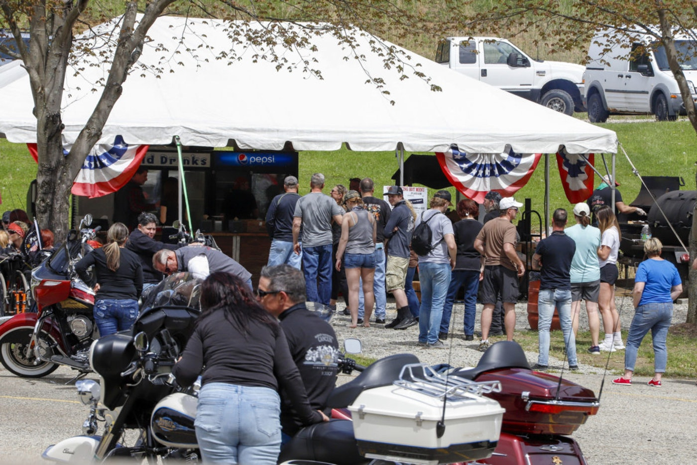 A crowd waits for barbecue in the parking lot of the historic Stonehouse Inn during the coronavirus pandemic in Farmington, Pa., Saturday, May 16, 2020. (AP Photo/Gene J. Puskar)