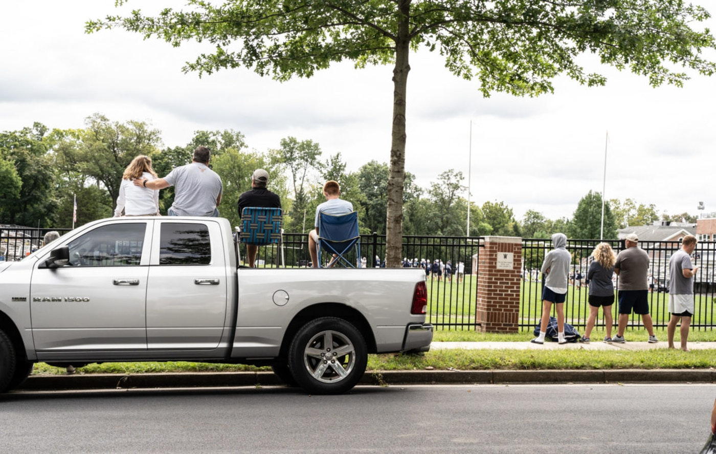 Fans watch a football game from outside a stadium in Berks County on Sept. 12, 2020, as crowds are limited at sporting events in Pennsylvania. (Shutterstock Image/Amy Lutz)