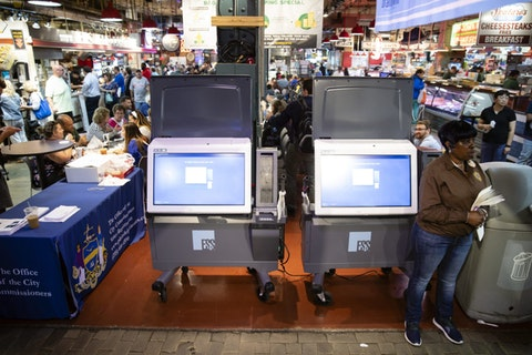 In this June 13, 2019, file photo, ExpressVote XL voting machines are displayed during a demonstration at the Reading Terminal Market in Philadelphia. (AP Photo/Matt Rourke, File)