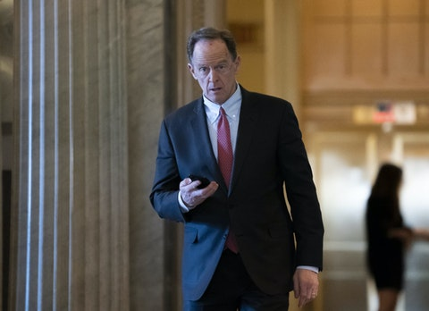 In this Feb. 3, 2020, file photo, Sen. Pat Toomey, R-Pa., walks at the Capitol in Washington. (AP Photo/J. Scott Applewhite, File)