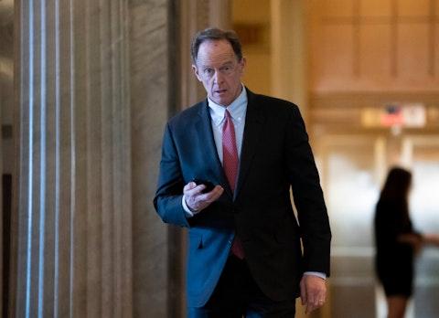 In this Feb. 3, 2020, file photo, Sen. Pat Toomey, R-Pa., walks at the Capitol in Washington. (AP Photo/J. Scott Applewhite, File)