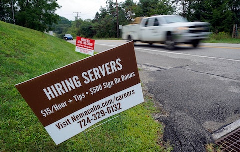 Help wanted signs for servers and cooks at Nemacolin Woodlands Resort and Spa are displayed along route 40 at the entrance to the resort in Farmington, Pa., in September. People continue to look for work in the state.