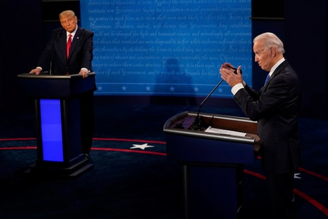 Democratic presidential candidate and former Vice President Joe Biden answers a question as President Donald Trump listens during the second and final presidential debate Thursday, Oct. 22, 2020, at Belmont University in Nashville, Tenn. (AP Photo/Morry Gash)