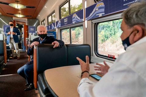 Democratic presidential candidate former Vice President Joe Biden speaks with United Steelworkers Union President Thomas Conway, right, aboard his train as it travels to Pittsburgh, Wednesday, Sept. 30, 2020. Biden is on a train tour through Ohio and Pennsylvania. (AP Photo/Andrew Harnik)