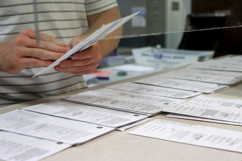 In this May 28, 2020, file photo processing work on mail in ballots for the Pennsylvania Primary election is being done at the Butler County Bureau of Elections, in Butler, Pa.  (AP Photo/Keith Srakocic, File)