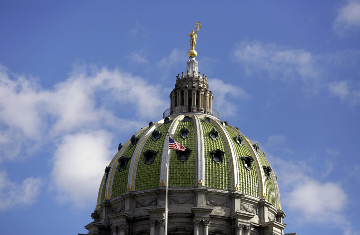 The American flag flies at the Pennsylvania State Capitol building Oct. 24, 2018, in Harrisburg, Pa. (AP Photo/Jacqueline Larma)